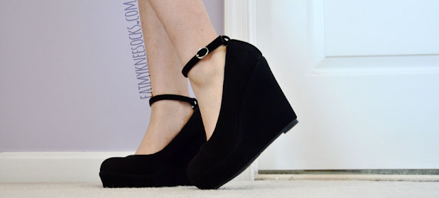 Milanoo's lovely black wedges are made with a simple ankle strap design and faux-suede material.