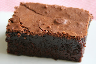 slice of chocolate brownie - chewy center with a crispy top