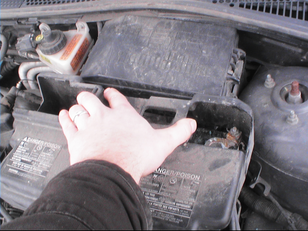 Fh auto repair how to change the battery on a 2000 2007 ford focus pull the plastic cover off sciox Image collections