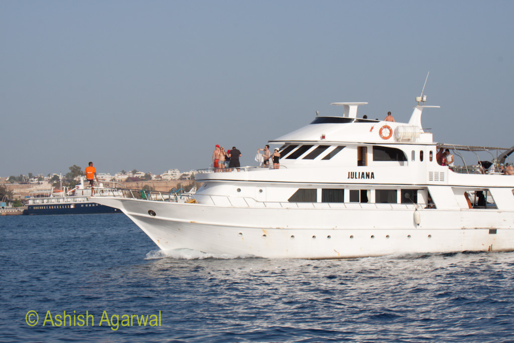 Tourists on board a small ship in the waters of the Red Sea in Sharm el Sheikh harbor in Egypt