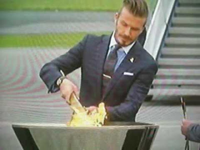 I BET VICTORIA BECKHAM LOVES THE WAY HE LIT THE OLYMPIC TORCH