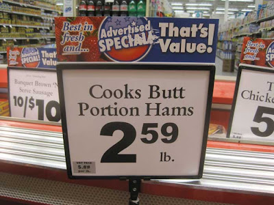 Sign in a meat cooler reading Cooks Butt / Portion Hams