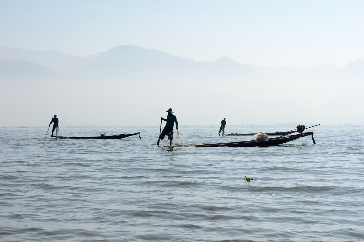 Fishermen on Inle Lake on a foggy morning