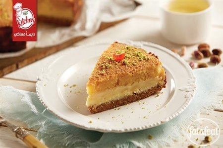 mix the ingredients of the second layer at medium speed Basbousa Cheesecake Recipe