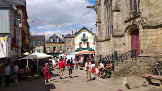Sit outside on a cafe for a coffee or lunch after shopping at Josselin market