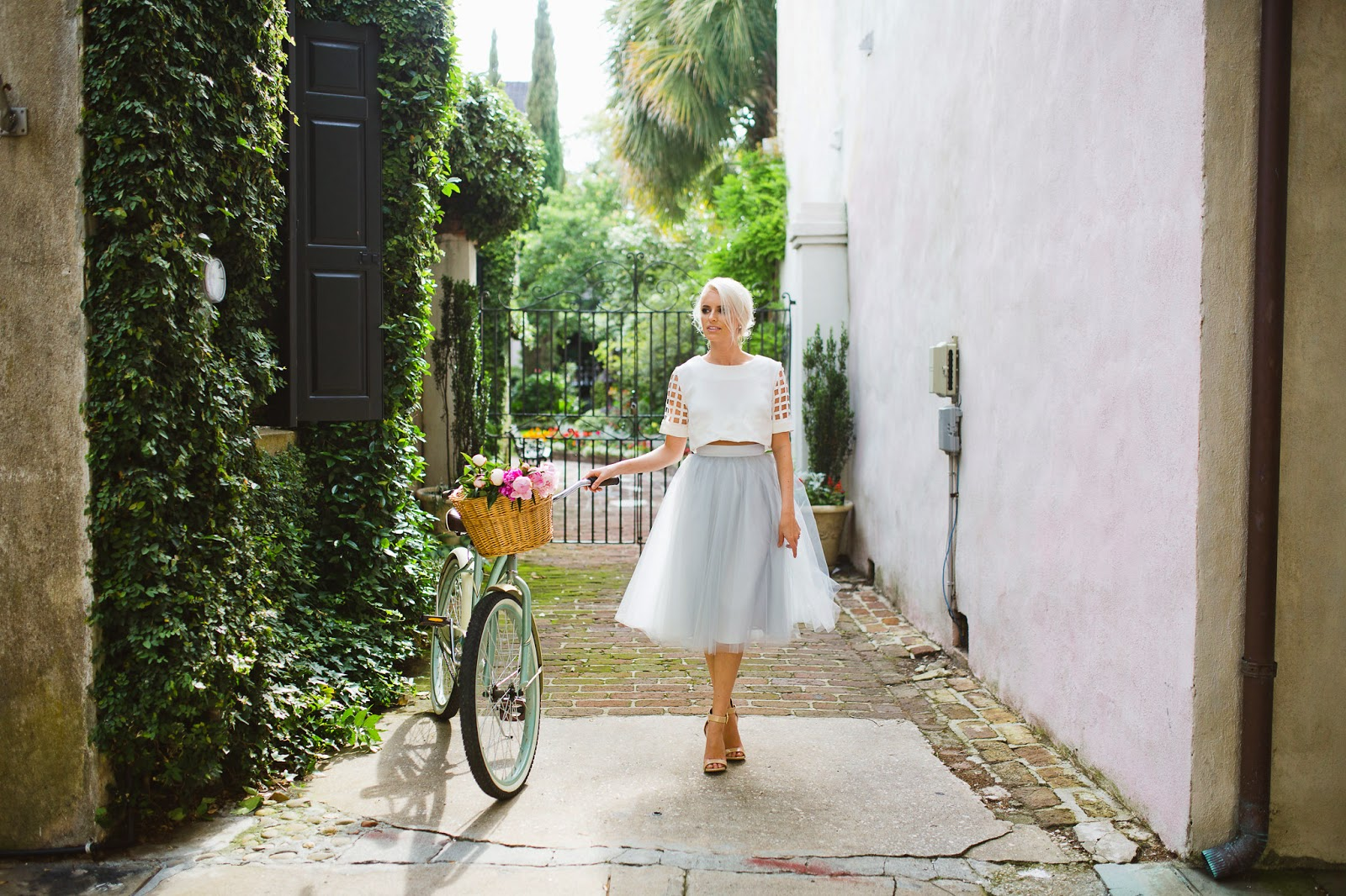 "downtown Charleston fashion blogger dannon k collard like the yogurt blog street style trend tulle skirt alexandra grecco pale gray 30"" tobi fair and square top crop white nude 2 strap sandals steve madden marlenee cobblestone streets rome europe european florals spring vintage bike platinum hair updo pretty"