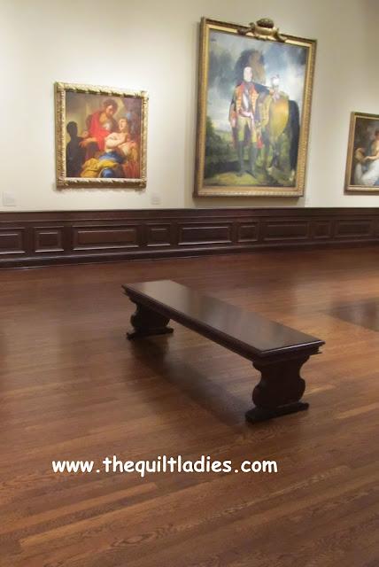 a wooden bench at an art museum