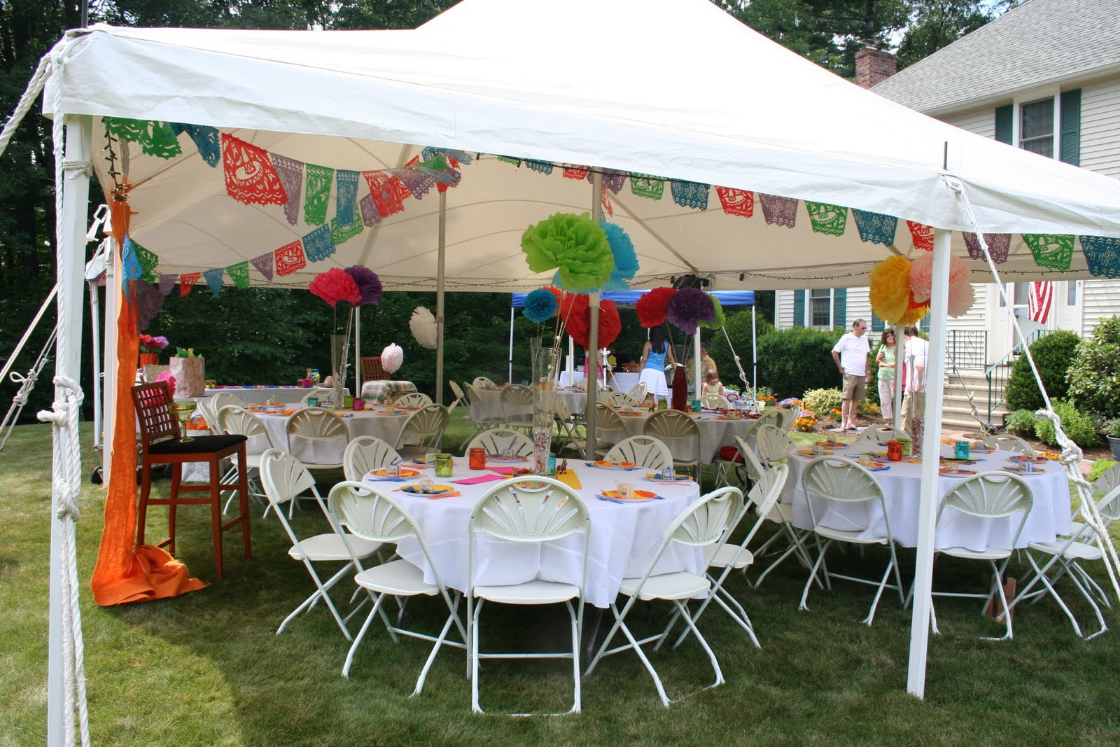 The tent with round tables Mexican Papercut flags and large tissue paper flowers on each table. & Celebrate!: Fiesta Wedding Shower