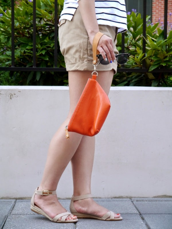 J. Crew Marina espadrille sandals, khaki shorts, orange Roots wristlet pouch, Benji Frank shades