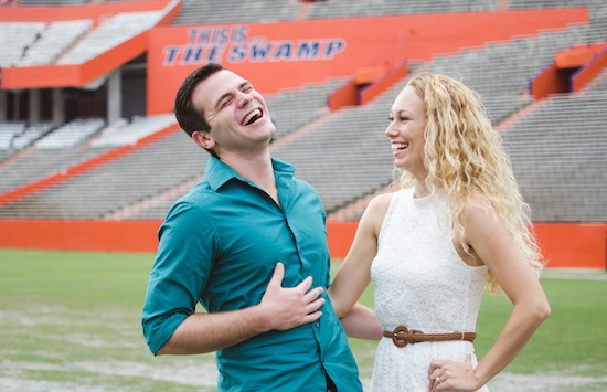couple laughing together on the Florida Gators football field