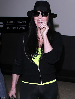 Cher grinning whilst passing through LAX airport