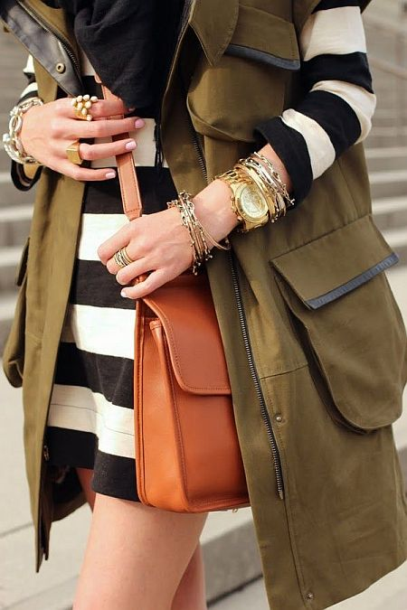 street style: military vest with black and white striped dress and gold jewellery