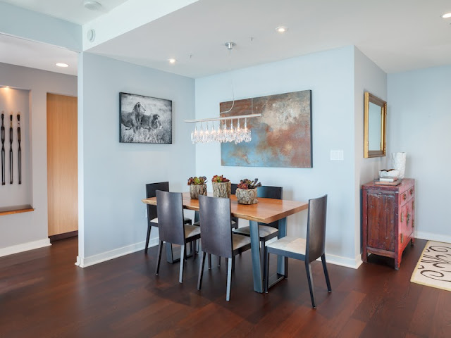 Picture of small dining room with wooden table and black chairs