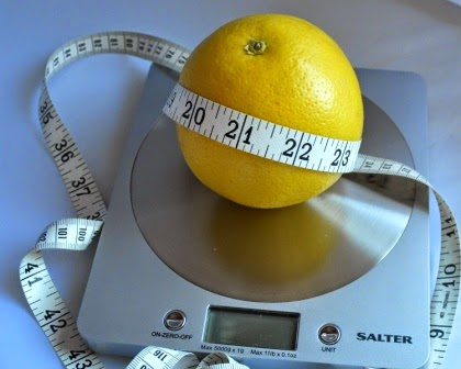 grapefruit and tape measure
