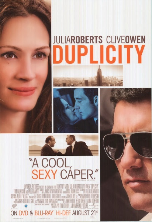 Duplicity (Released in 2009) - A comedy romantic thriller - Starring Clive Owen, Julia Roberts, Tom Wilkinson, Paul Giamatti