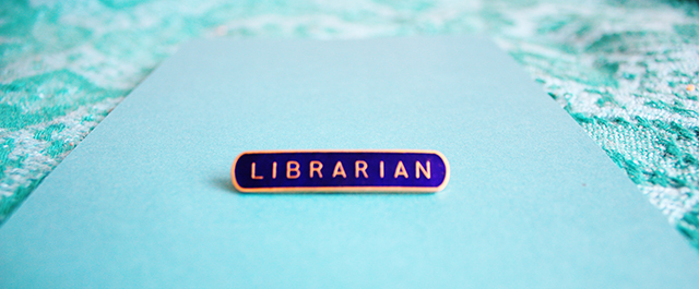 blue and gold librarian badge