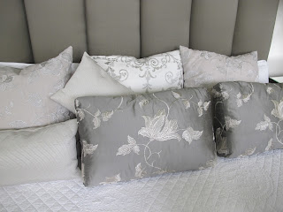 Get a styled look when adding lots of different bedroom display cushions with your upholstered headboard.