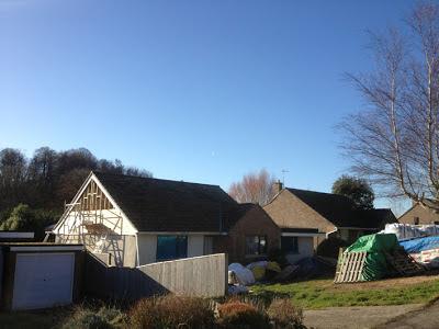 blue sky, sunshine and half a cedar-clad gable