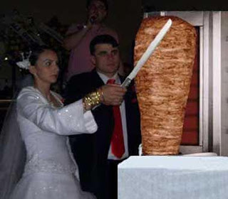 Funny pictures of the wedding, the newlywed couple cut doner meat together