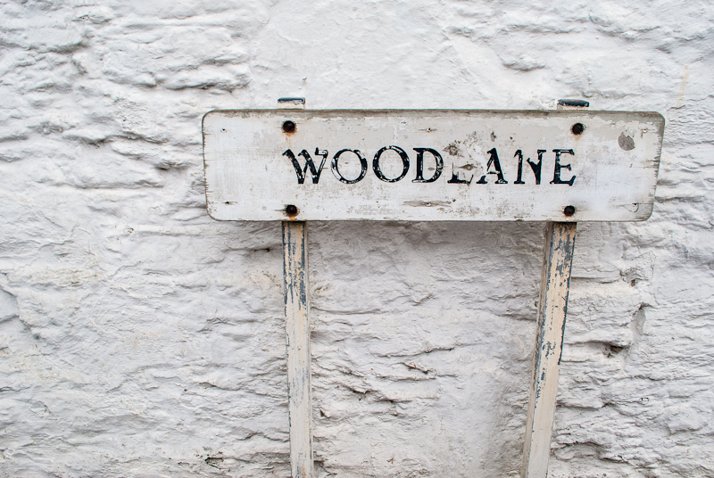 image of the woodlane street sign in falmouth cornwall, england.