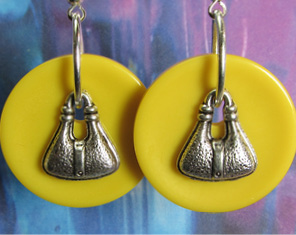 Big drop dangle earrings with silver fashion charms layered over large yellow buttons