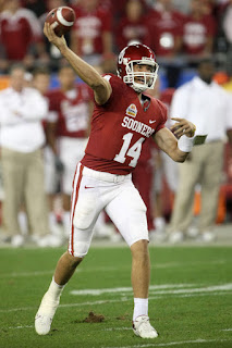 Quarterback Sam Bradford #14 of the Oklahoma Sooners passes the ball in the first quarter against the West Virginia Mountaineers at the Tostito's Fiesta Bowl at University of Phoenix Stadium January 2, 2008 in Glendale, Arizona. (January 1, 2008 - Source: Stephen Dunn/Getty Images Sport)