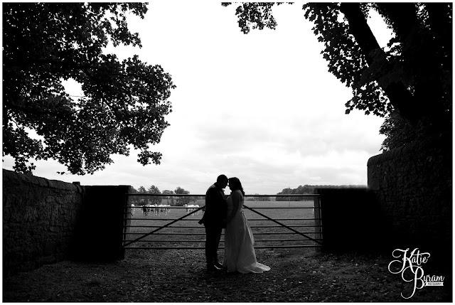 bride in window, bridal prep, vintage wedding, high house farm brewery wedding, northumberland wedding photography katie byram photography, black and white wedding photograph, countryside wedding