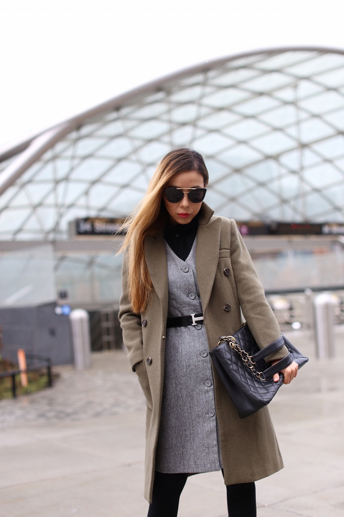 Olive coat, grey belted dress, work attire, casadei ankle booties, prada sunglasses, chanel grand shopping tote, nyc street style, how to dress from work to play, hermes belt