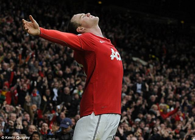 Inspiration: Rooney celebrates after scoring his spectacular overhead-kick in February 2011