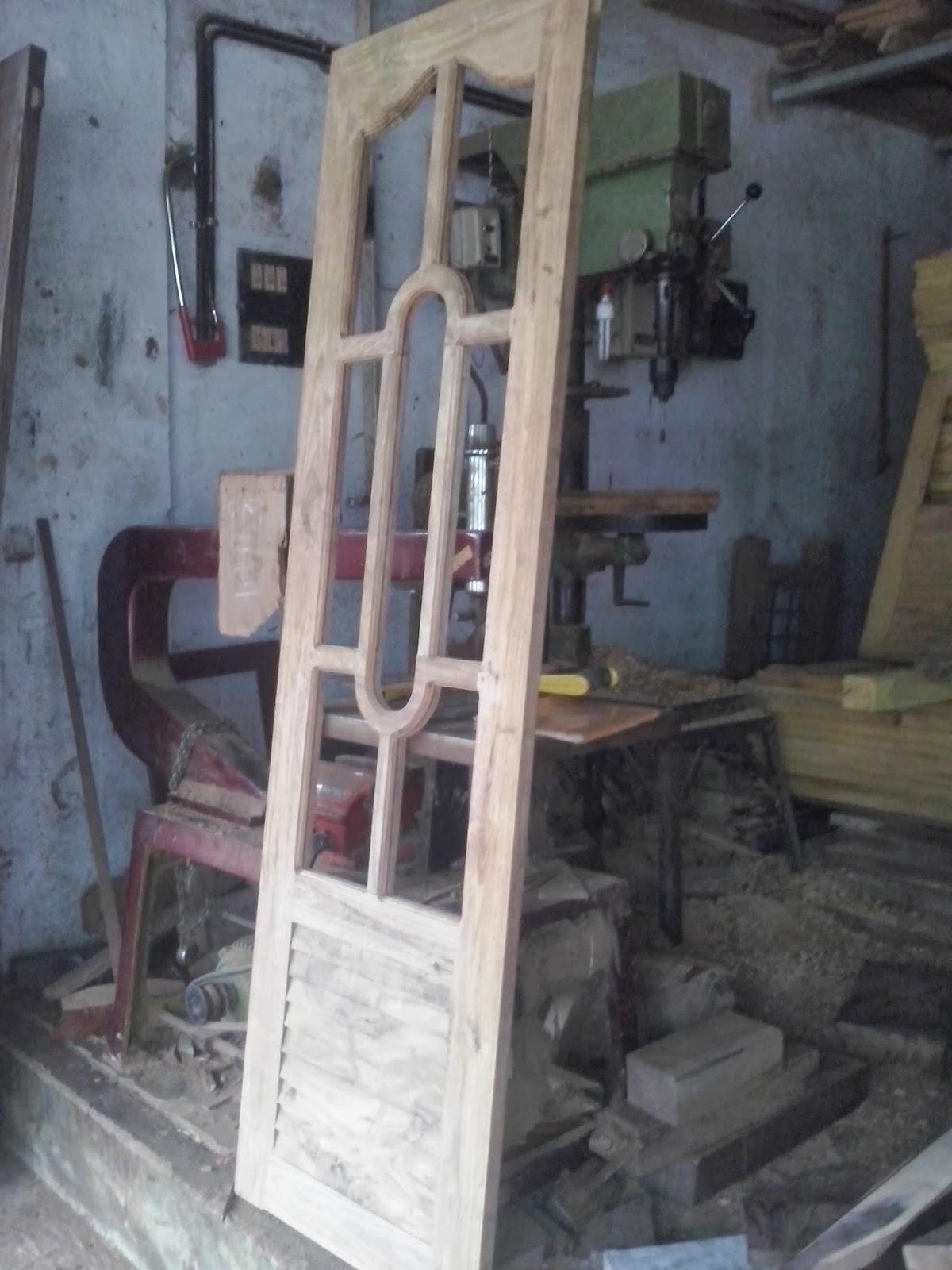 Bavas wood works for Window design kerala style