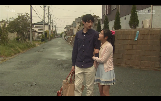 Naoki walks an injured Kotoko home. Kotoko clings to Naoki more than perhaps is necessary.