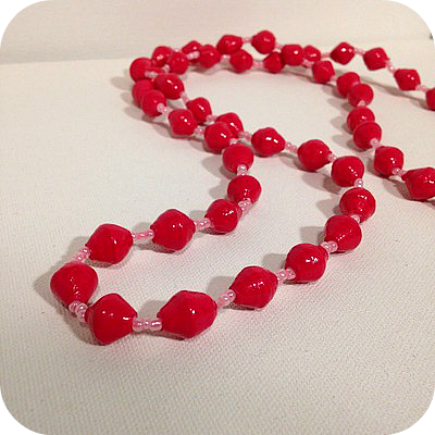http://loveuganda.storenvy.com/products/12034037-pink-bead-necklace
