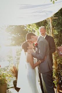 Smiles every where as Jon and Juanita embrace at their wedding ceremony - Kent Buttars, Seattle Wedding Officiant
