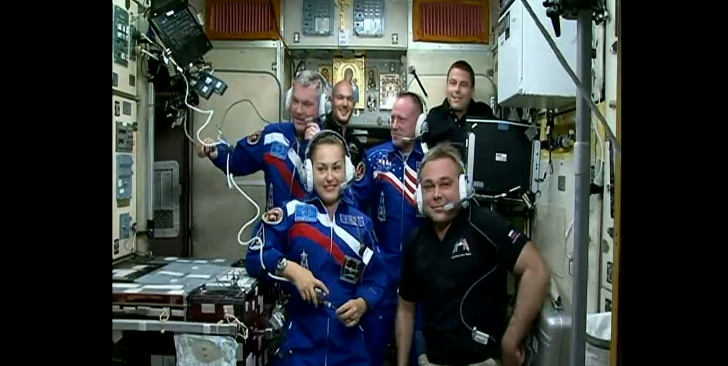 The new six-member Expedition 41 crew gathers in the Zvezda service module for a welcoming ceremony with family and friends in Baikonur, Kazakhstan. Image Credit: NASA TV