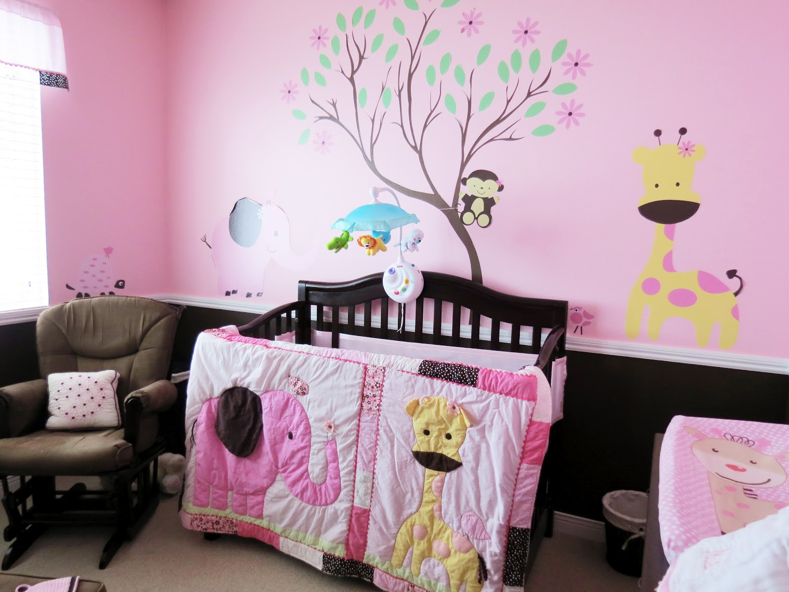Creative tradition pink chocolate baby girl jungle for Baby girl crib decoration ideas