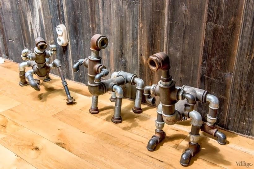 Steel pipe sculptures in Industrial interior design duplex apartment in Moscow