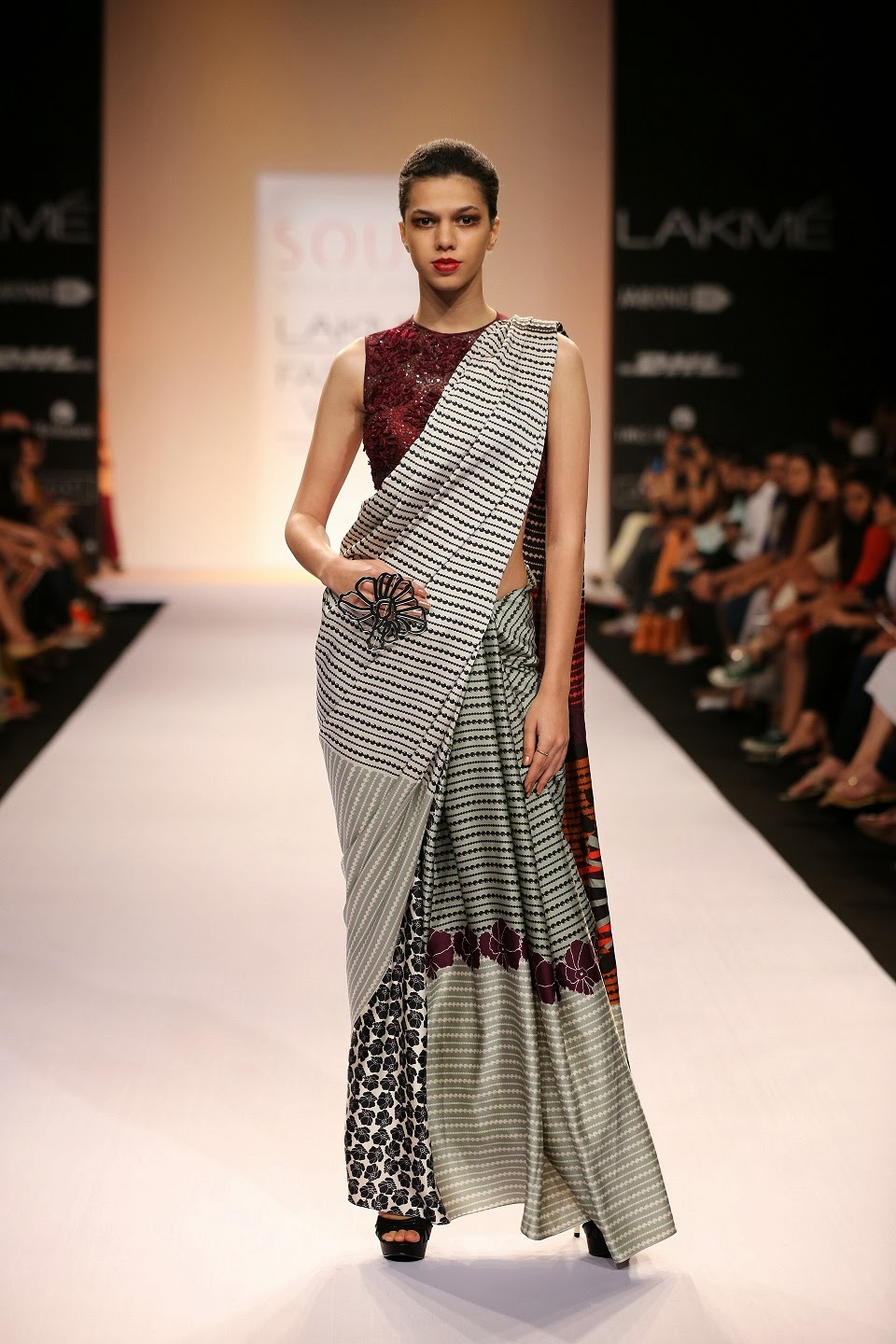 While the silhouette was basic, it was the pleating and draping that added drama to the garments. Beaded tassels appeared for colour blocked pre-stitched saris and were easy on the eye.