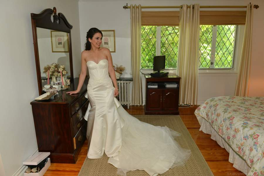 Bride poses after her wedding dress is on