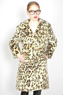 Vintage 1960's leopard print faux fur peacoat with button front closure.