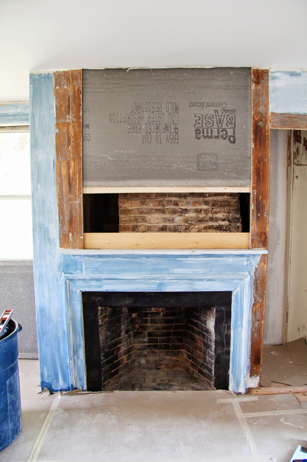 in the fields putting back the fireplace panels