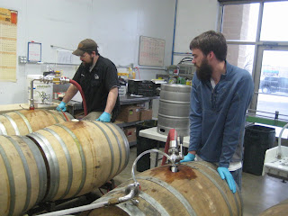 "Transferring aged lambic into ""new"" barrels."