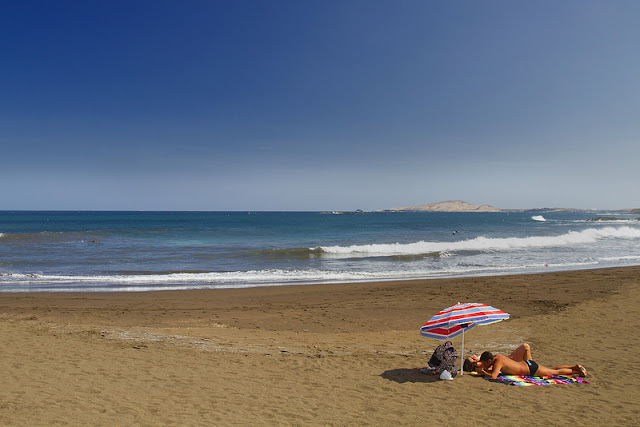 Melenara Beach in Gran Canaria is sunny and famous for its seafood restaurants.