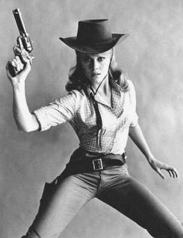 Jane Fonda legs spread holding pistol