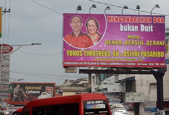 Inilah Pengakuan Yunus Timotheus Mundur dari Pencalonan Walikota Siantar - Baliho Pasangan Yunus Timotheus dan Oslyne Pasaribu yang terpajang di pusat Kota Siantar
