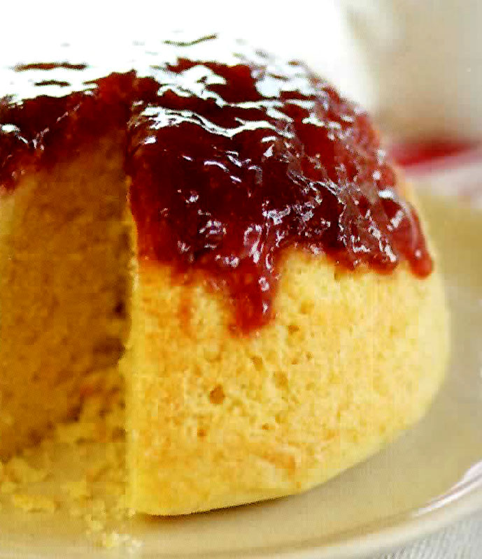basic steamed white sponge pudding with a strawberry jam topping