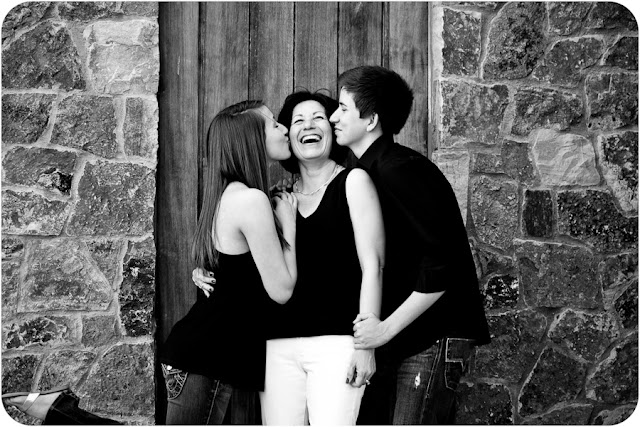 Daughter and Son kissing Mom on Cheek