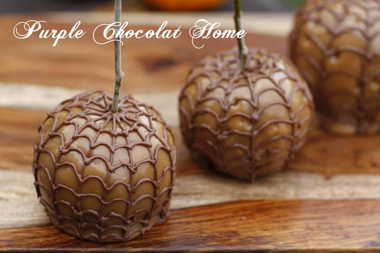 Spider webbed caramel apples purple chocolat home for Caramel apple recipes for halloween