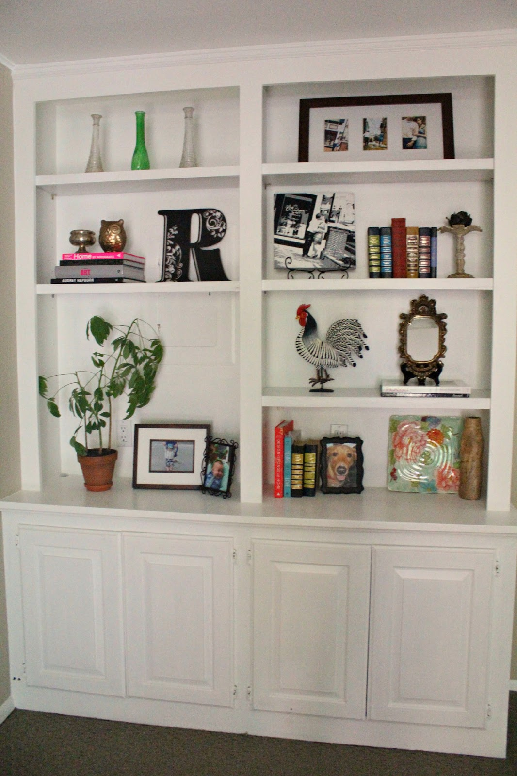 Ten june my living room built in bookshelves are styled - Shelves design for living room ...