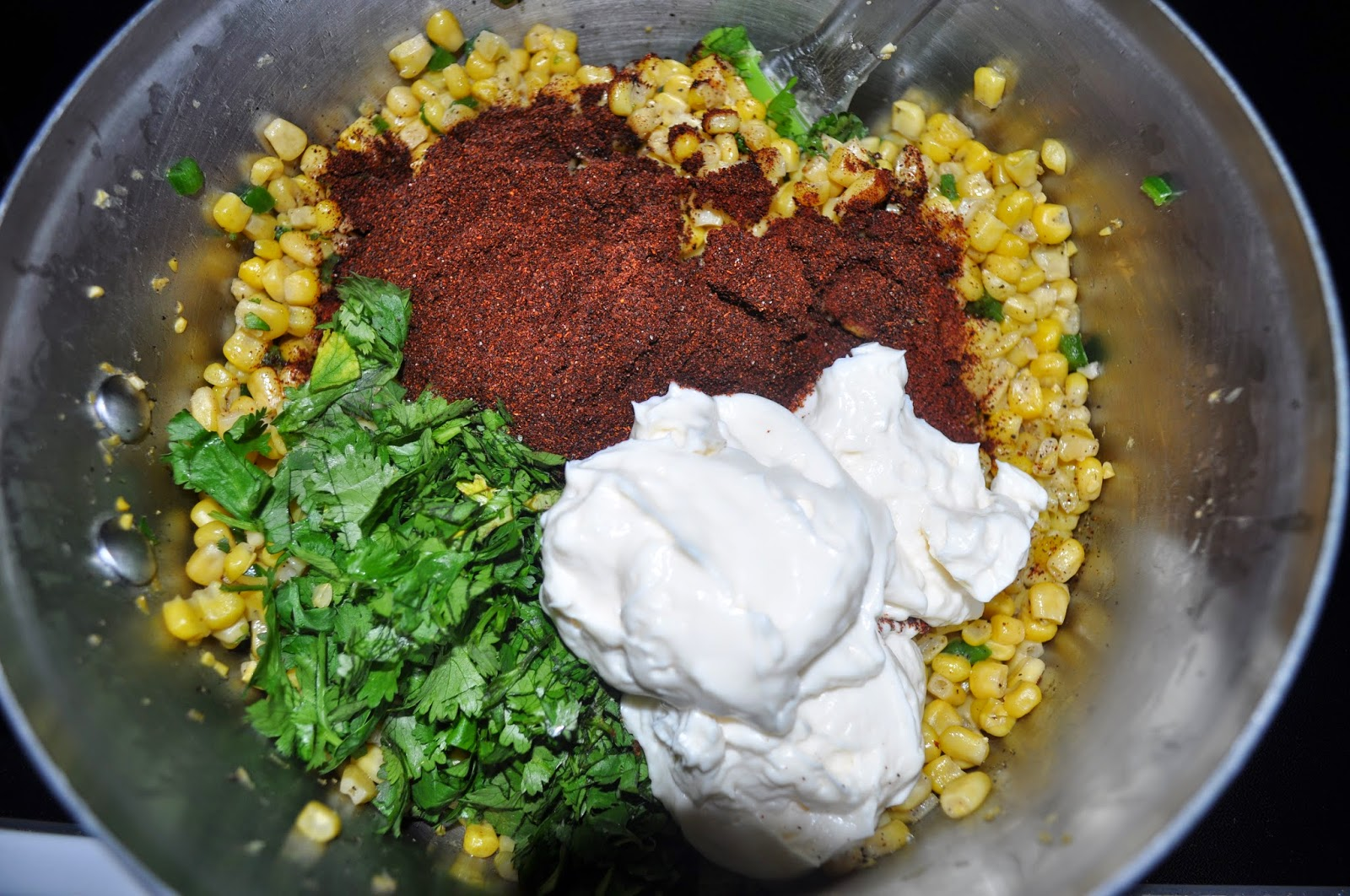 cilantro, corn, salad, goat cheese, mayo, chili, chili powder, lime, mexican corn salad, side dish, party, food, tasty, yummy, jalopeno, pepper, recipes, ingrediants