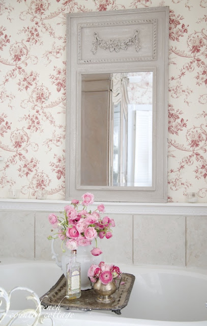 French style mirror in bathroom with toile wallpaper